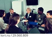 Купить «Business people of different nationalities developing strategy for teamwork», фото № 29060809, снято 12 февраля 2018 г. (c) Яков Филимонов / Фотобанк Лори