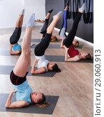 Купить «Group of females exercising during yoga class at gym», фото № 29060913, снято 29 января 2018 г. (c) Яков Филимонов / Фотобанк Лори