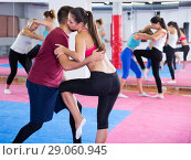 Купить «female train with a coach in pairs on a karate class», фото № 29060945, снято 8 октября 2017 г. (c) Яков Филимонов / Фотобанк Лори