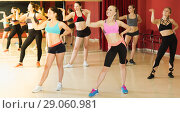 Купить «Portrait of young fitness females practicing zumba», фото № 29060981, снято 31 мая 2017 г. (c) Яков Филимонов / Фотобанк Лори