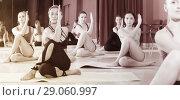 Купить «elastic women practice yoga», фото № 29060997, снято 31 мая 2017 г. (c) Яков Филимонов / Фотобанк Лори