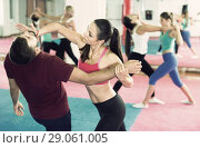 Купить «Sporty girl with her instructor are training self-defence moves», фото № 29061005, снято 8 октября 2017 г. (c) Яков Филимонов / Фотобанк Лори