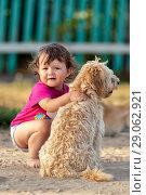 Купить «Маленькая девочка сидит на корточках и обнимает собаку», фото № 29062921, снято 18 октября 2018 г. (c) Александр Гаценко / Фотобанк Лори
