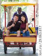 Купить «Adult girl with boyfriend traveling on rickshaw», фото № 29063817, снято 22 мая 2018 г. (c) Яков Филимонов / Фотобанк Лори