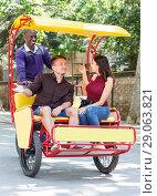 Купить «Joyful girl with boyfriend traveling on rickshaw», фото № 29063821, снято 22 мая 2018 г. (c) Яков Филимонов / Фотобанк Лори
