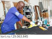 Купить «workman working with glass in workshop», фото № 29063845, снято 16 мая 2018 г. (c) Яков Филимонов / Фотобанк Лори