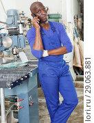 Купить «Workman having phone conversation», фото № 29063881, снято 16 мая 2018 г. (c) Яков Филимонов / Фотобанк Лори