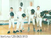 Купить «Portrait of happy mixed age group of athletes», фото № 29063913, снято 30 мая 2018 г. (c) Яков Филимонов / Фотобанк Лори