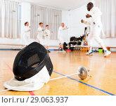 Купить «Closeup of fencing mask and rapier on floor in gym», фото № 29063937, снято 30 мая 2018 г. (c) Яков Филимонов / Фотобанк Лори
