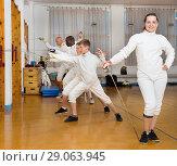 Купить «Female fencer standing in gym», фото № 29063945, снято 30 мая 2018 г. (c) Яков Филимонов / Фотобанк Лори