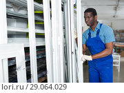 Купить «Male master is working with window frame», фото № 29064029, снято 16 мая 2018 г. (c) Яков Филимонов / Фотобанк Лори