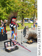 Купить «Уличный концерт музыканта в индейском национальном костюме», фото № 29064817, снято 8 сентября 2018 г. (c) Ирина Носова / Фотобанк Лори