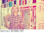 Купить «Female next to shelf with threads for sewing», фото № 29066197, снято 7 июня 2020 г. (c) Яков Филимонов / Фотобанк Лори
