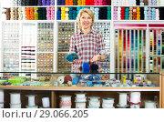 Купить «mature woman at counter in sewing store», фото № 29066205, снято 12 декабря 2018 г. (c) Яков Филимонов / Фотобанк Лори