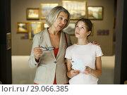 Купить «Woman and girl visiting museum», фото № 29066385, снято 18 августа 2018 г. (c) Яков Филимонов / Фотобанк Лори