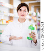 Купить «female pharmacist demonstrating assortment of pharmacy», фото № 29066521, снято 31 января 2017 г. (c) Яков Филимонов / Фотобанк Лори