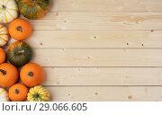 Купить «Pumpkins on wooden background», фото № 29066605, снято 14 октября 2017 г. (c) Иван Михайлов / Фотобанк Лори