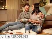 Купить «happy couple drinking cacao at home», фото № 29066685, снято 13 января 2018 г. (c) Syda Productions / Фотобанк Лори