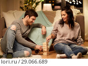 Купить «happy couple playing block-stacking game at home», фото № 29066689, снято 13 января 2018 г. (c) Syda Productions / Фотобанк Лори