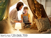 Купить «family with tablet pc in kids tent at home», фото № 29066709, снято 27 января 2018 г. (c) Syda Productions / Фотобанк Лори