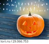 Купить «close up of halloween pumpkin on table», фото № 29066753, снято 17 сентября 2014 г. (c) Syda Productions / Фотобанк Лори
