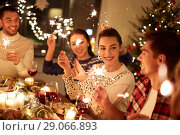 Купить «happy friends celebrating christmas at home feast», фото № 29066893, снято 17 декабря 2017 г. (c) Syda Productions / Фотобанк Лори
