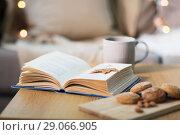 Купить «book with autumn leaf, cookies and tea on table», фото № 29066905, снято 15 ноября 2017 г. (c) Syda Productions / Фотобанк Лори