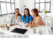 Купить «businesswomen discussing papers at office», фото № 29066953, снято 17 марта 2018 г. (c) Syda Productions / Фотобанк Лори