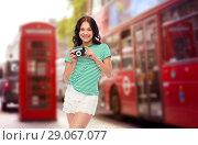 Купить «teenage girl with film camera over london street», фото № 29067077, снято 30 июня 2018 г. (c) Syda Productions / Фотобанк Лори