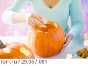 Купить «hands with candle and halloween pumpkin», фото № 29067081, снято 17 сентября 2014 г. (c) Syda Productions / Фотобанк Лори