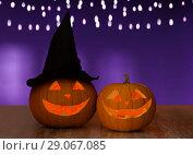 Купить «close up of halloween pumpkins on table», фото № 29067085, снято 17 сентября 2014 г. (c) Syda Productions / Фотобанк Лори