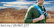 Купить «close up of man with backpack over grand canyon», фото № 29067277, снято 27 мая 2016 г. (c) Syda Productions / Фотобанк Лори