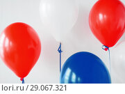 Купить «party decoration with red, white and blue balloons», фото № 29067321, снято 6 июля 2017 г. (c) Syda Productions / Фотобанк Лори