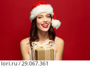 Купить «woman with red lipstick in santa hat at christmas», фото № 29067361, снято 5 января 2018 г. (c) Syda Productions / Фотобанк Лори
