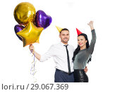 Купить «happy couple with party caps and balloons», фото № 29067369, снято 3 марта 2018 г. (c) Syda Productions / Фотобанк Лори
