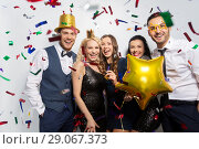 Купить «friends with party props and confetti laughing», фото № 29067373, снято 3 марта 2018 г. (c) Syda Productions / Фотобанк Лори