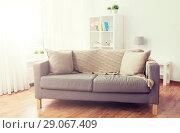 Купить «sofa with cushions at cozy home living room», фото № 29067409, снято 9 сентября 2017 г. (c) Syda Productions / Фотобанк Лори