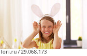Купить «girl in easter bunny ears playing peek a boo game», видеоролик № 29068173, снято 10 августа 2018 г. (c) Syda Productions / Фотобанк Лори