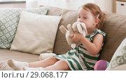 Купить «baby girl playing with toy rabbit at home», видеоролик № 29068177, снято 10 августа 2018 г. (c) Syda Productions / Фотобанк Лори