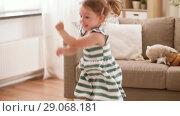 Купить «happy baby girl jumping and having fun at home», видеоролик № 29068181, снято 10 августа 2018 г. (c) Syda Productions / Фотобанк Лори