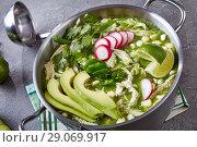 Купить «overhead view of Chicken Pozole Verde», фото № 29069917, снято 16 августа 2018 г. (c) Oksana Zh / Фотобанк Лори
