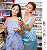 Купить «Attractive young girl and female testing face powder at cosmetics store», фото № 29070081, снято 21 июня 2018 г. (c) Яков Филимонов / Фотобанк Лори