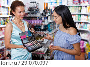 Купить «Stylish woman and daughter choosing eyeshadows in store», фото № 29070097, снято 21 июня 2018 г. (c) Яков Филимонов / Фотобанк Лори