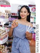 Купить «Young girl choosing new perfume in modern cosmetic store», фото № 29070105, снято 21 июня 2018 г. (c) Яков Филимонов / Фотобанк Лори