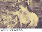 Купить «female customer in art department», фото № 29070225, снято 26 июня 2019 г. (c) Яков Филимонов / Фотобанк Лори