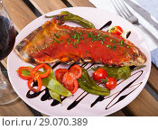 Купить «Mutton ribs baked under hot tomato sauce with red wine», фото № 29070389, снято 4 июля 2020 г. (c) Яков Филимонов / Фотобанк Лори