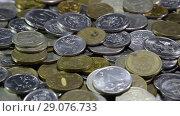 Купить «A lot of coins and cents rubles. Throwing coins into a common heap. Russian rubles.», видеоролик № 29076733, снято 24 июля 2019 г. (c) Леонид Еремейчук / Фотобанк Лори