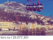Купить «Aerial view of Grenoble with French Alps and cable car», фото № 29077301, снято 7 декабря 2017 г. (c) Яков Филимонов / Фотобанк Лори
