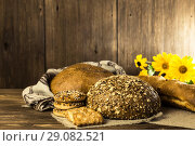Food. Rustic still life. Assortment of fresh bread baked in a bakery and cookies on the background of a wooden table texture. Стоковое фото, фотограф Светлана Евграфова / Фотобанк Лори
