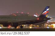 Купить «Sheremetyevo Airport with Terminal F and Aeroflot planes a night, Moscow», видеоролик № 29082537, снято 4 октября 2017 г. (c) Данил Руденко / Фотобанк Лори